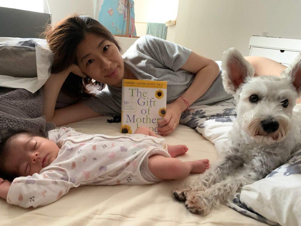 Yuri holding the Gift of Motherhood book